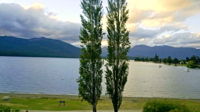 Aerial view of big lake in Te Anau at sunset, New Zealand video