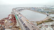 Aerial view of big modern viaduct or bridge at the background of cable-stayed bridge and zenit arena stadium video