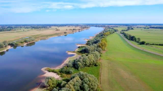 Aerial View of biosphere reserve 'Niedersächsische Elbtalaue' and River Elbe near by Hitzacker in Lower Saxony, Germany video