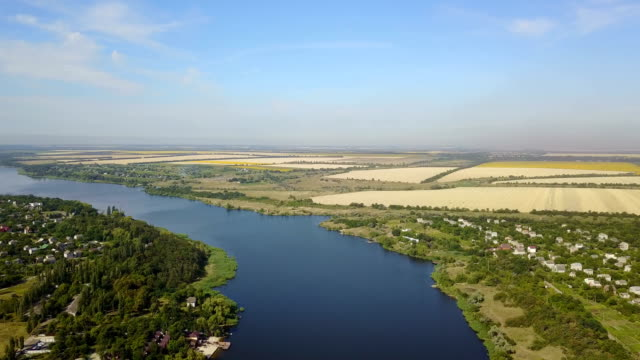 Aerial View Of Blue River With Small Village And Fields On Banks, Drone Shot Of Rural Summer Landscape video