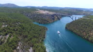 Aerial view of boat sailing towards Krka bridge, Croatia video