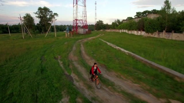 Aerial view of boy riding bike in the countryside video