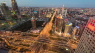 T/L WS HA PAN Aerial View of Busy Overpass, Dusk to Night Transition / Beijing, China video