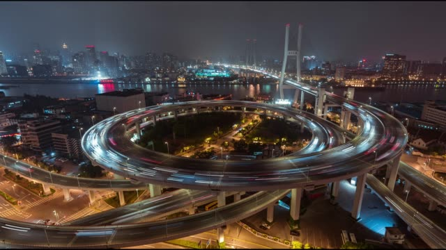 T/L WS HA PAN Aerial View of Busy Overpass in Shanghai at Night, Nanpu Bridge video