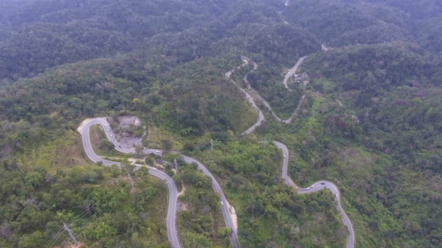 Aerial view of cars driving along the  winding road on mountain, snake road video