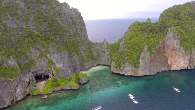 Aerial view of cave and beach with beautiful cliff at Phi Phi island, Thailand video