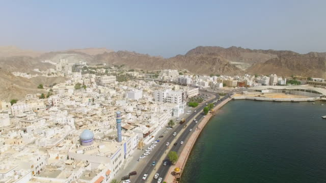 Aerial view of cityscape of Muscat, harbor and capital city of Oman, sultanate on Arabian Peninsula, 4k UHD video