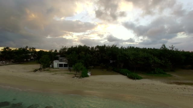 Aerial view of coast from water camera moving to coast, Mauritius Island video