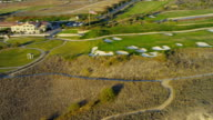 Aerial view of coastal golf course, USA video