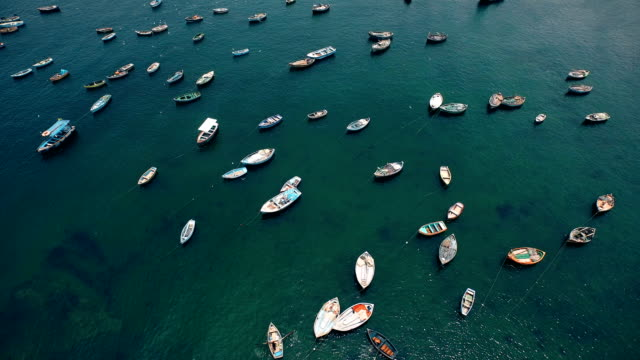 Aerial view of colorful peruvian fishing boats in harbor video