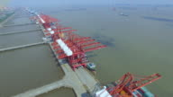 Aerial view of commercial dock with cargo containers in shanghai. video