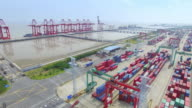 Aerial view of commercial dock with cargo containers in shanghai.4k video