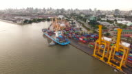 Aerial View of Commercial Port with Many Containers and Ship at Dusk video