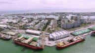 Aerial view of container ship anchored in the Port of Kaohsiung loaded with containers video