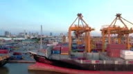 Aerial View of Container Ship in Industrial Port at Sunset video