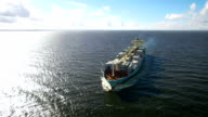 Aerial view of container ship sailing in the sea video
