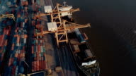 aerial view of containers on dock at port video