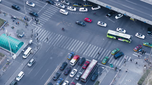 T/L MS HA Aerial View of Crowds of People Crossing Street / Beijing, China video
