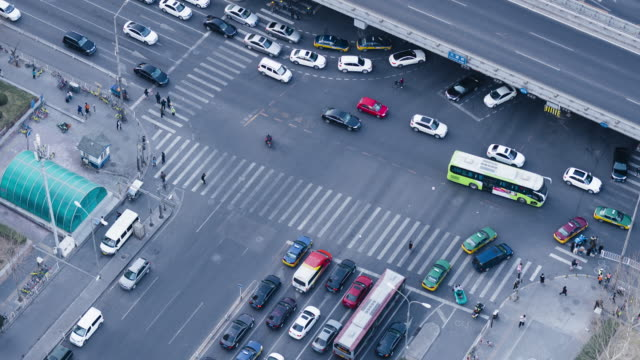 T/L MS HA TD Aerial View of Crowds of People Crossing Street / Beijing, China video