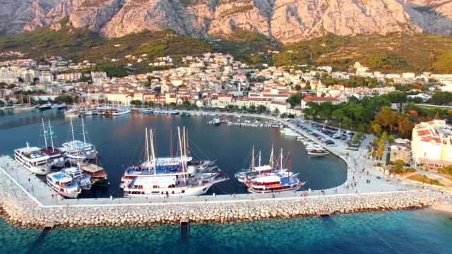 Aerial view of dalmatian harbour with houses and football stadium video
