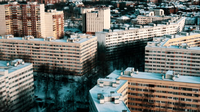Aerial view of dormitory area with multi story houses covered in snow video
