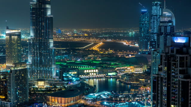 Aerial view of Dubai downtown Lake area night timelapse and skyscrapers of Old Town Island, from top. Skyline urban city of Dubai video