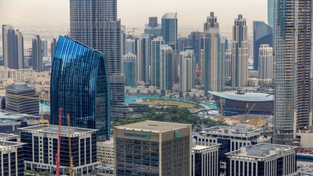 Aerial view of Dubai downtown Lake area timelapse and skyscrapers of Old Town Island, from top. Skyline urban city of Dubai video
