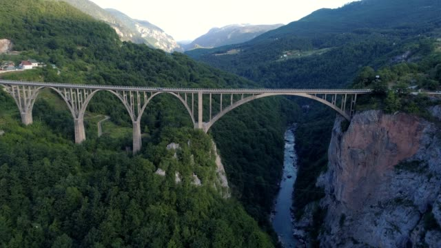 Aerial view of Durdevica Tara arc bridge in the mountains, One of the highest automobile bridges in Europe video