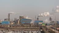 T/L WS HA ZI Aerial View of Factory with Smokestacks / Shandong, China video