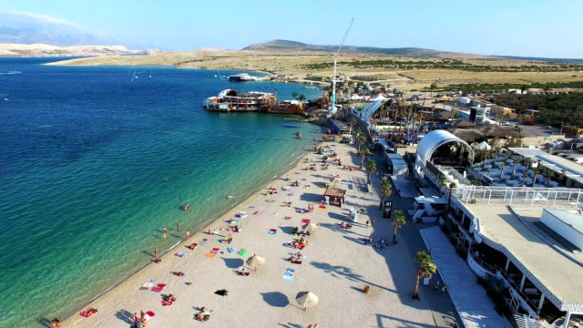 Aerial view of famous zrce party beach of Pag island in the morning, Croatia video