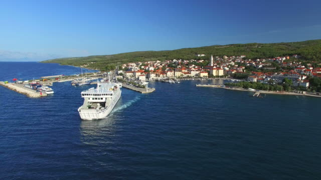 Aerial view of ferry leaving port in Supetar, Croatia video