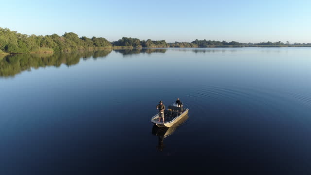 Aerial view of Fisherman fly fishing from a boat video
