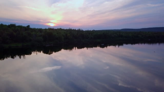Aerial view of Fishermans Fly Fishing in Canoe at Sunset video