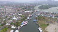 Aerial view of floating house on mount of river video