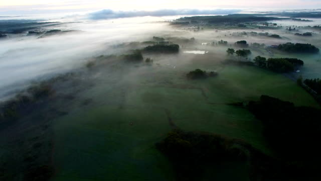 Aerial View Of Fog Mist Over Rural Countryside video