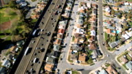 Aerial View of Freeway & Housing Suburbs video