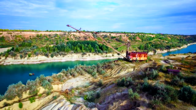 Aerial view of giant mining excavator in a sand quarry video