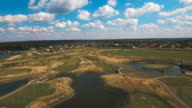 Aerial view of golf course and water video