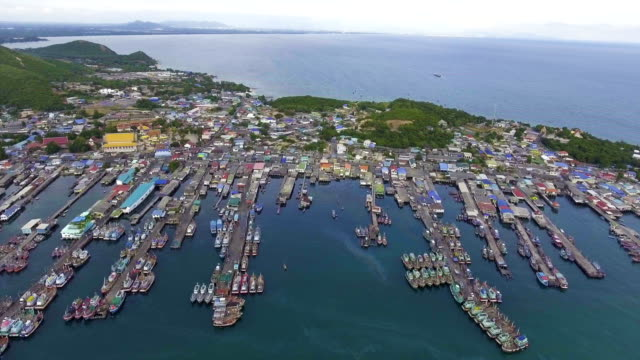 Aerial View of Harbor with Jitty along Coast in Fisherman Village with Drone. Dolly shot. video