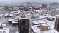 Aerial view of high rise apartments in a snowy city video