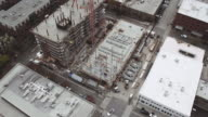Aerial view of high rise being constructed video