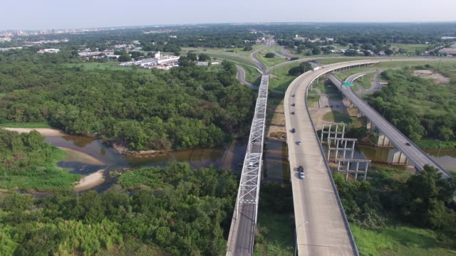 Aerial view of Highway and Overpass  with cars and trucks - Montopolis Bridge, Austin, Texas, USA video
