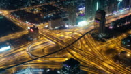 Aerial view of highway junction in Dubai, UAE. View from the height of Burj Khalifa timelapse video