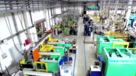 Aerial view of industrial robots in factory video
