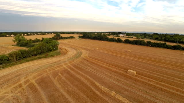 aerial view of Ireland fields with bale of straw video