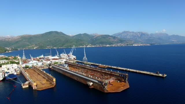 Aerial view of large floating dry dock for ship repairs video
