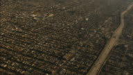 Aerial view of Los Angeles Suburbs out of plane window 4k video