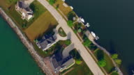 Aerial View of Luxury Homes Lining Scenic Waterfront Peninsula video