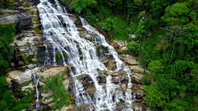 Aerial view of Mae Ya waterfall with spray of water Splashing one of the famous waterfall at Doi Inthanon National Park mountain. Located in Chiang Mai, Thailand. video