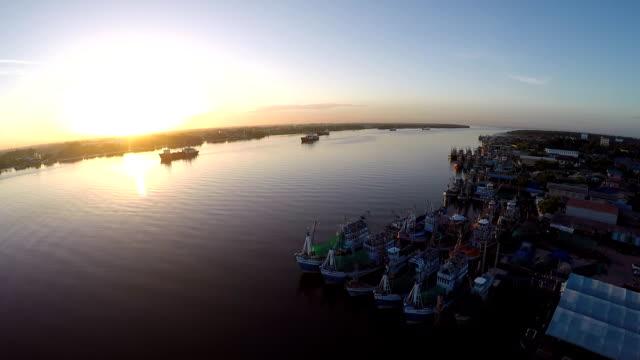 Aerial view of many fishing boat in harbor,Samutsakorn Thailand video